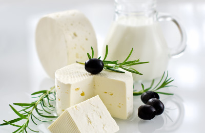 Healthy soft paneer cheese with rosemary and black olives